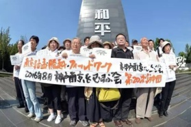 Japan's denial of past military aggression undermines world peace: People's Daily