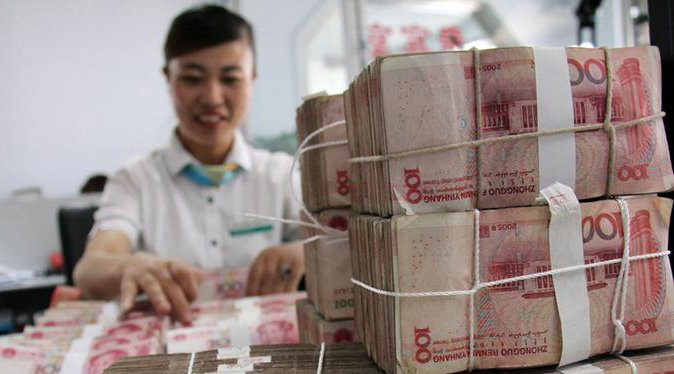 Central bank governor urges not to overreact to China's forex stockpile