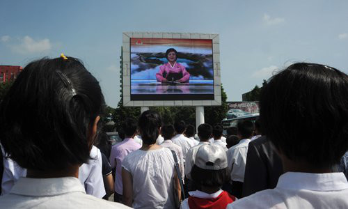 "Pyongyang residents watch TV announcer Ri Chun-hee talk about the successful launch of what North Korea called the intercontinental ballistic missile ""Hwasong-14,"" on a jumbo screen near the Pyongyang Railway Station on Tuesday. Photo: AFP"