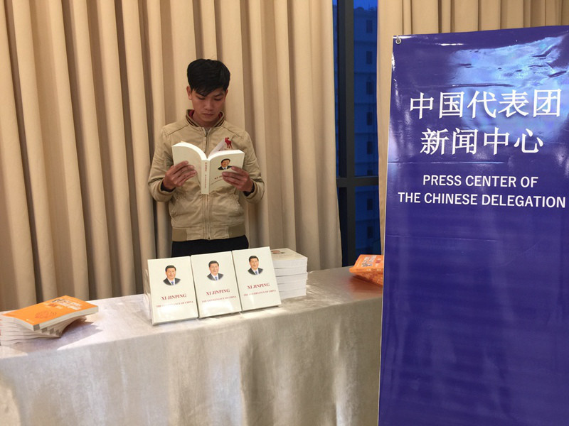 "A Vietnamese man reads Chinese President Xi Jinping's book ""The Governance of China"" at the press center of Chinese delegation to Da Nang APEC Summit."