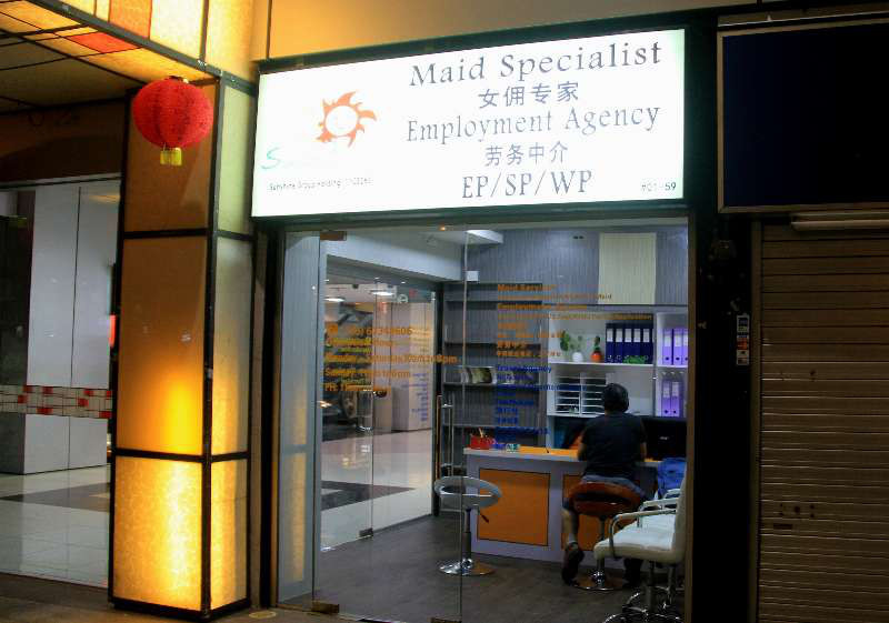 Caption: A maid employment agency near Orchard road in Singapore. Photo: Yu Yichun