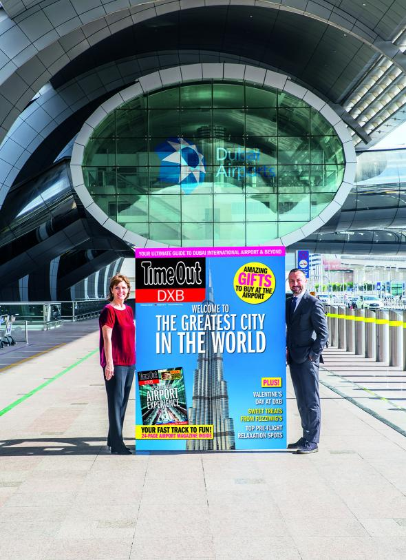 Sue Holt, Executive Director ITP Media Group and Eugene Barry, EVP Commercial at Dubai Airports with a larger than life Time Out DXB front cover (Photo: AETOSWIRE).