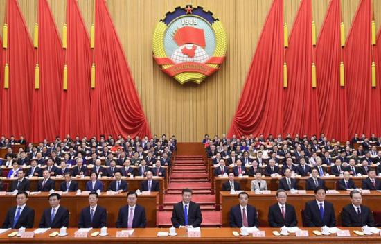 Op-ed: China's new type of party system enlightens world
