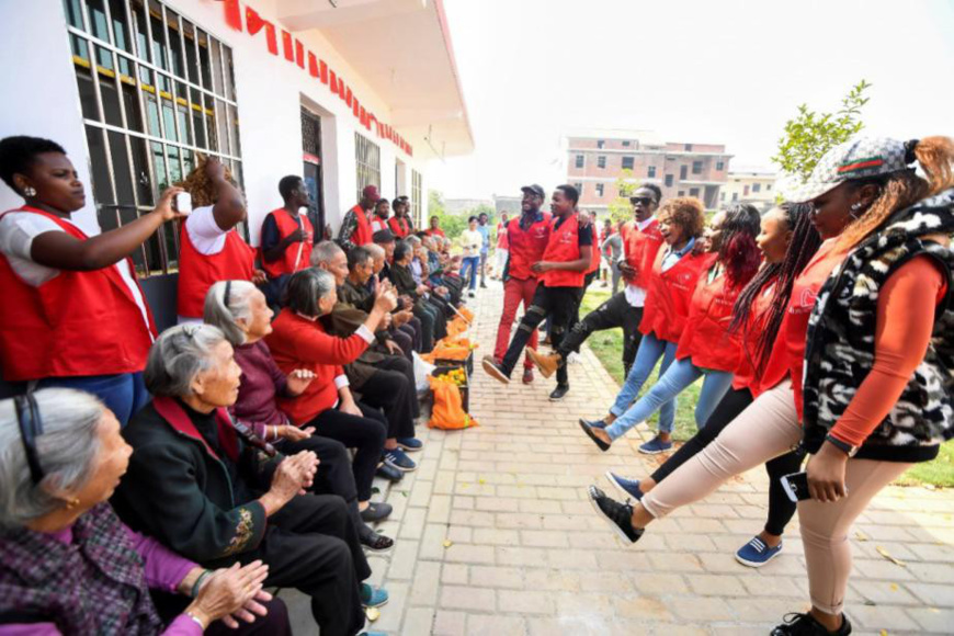 African students studying at Xinyu University, Jiangxi province dance for the elderly at a local nursing home, Oct. 28, 2017. (Photo by Zhou Liang from People's Daily Online)