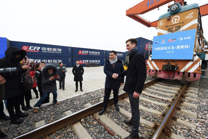 Chinese and Russian operators of a rail link between east China's Yiwu City and Moscow in Russia receive an interview on Jan. 30, 2018. On that day, a train carrying 100 standard containers of small commodities departed from the Yiwu West Railway Station for Russia, leaving China from Manchuria in the northeast. (Photo by Gong Xianming from People's Daily Online)