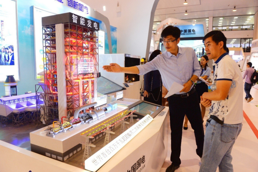 The scale model of the world's first GW double reheat ultra supercritical unit is exhibited in Beijing, Sept. 18, 2017. China's central SOEs were awarded over 400 national sci&tech prizes since the 18th CPC National Congress and owned more than 480,000 patents in total. (Photo from CFP)