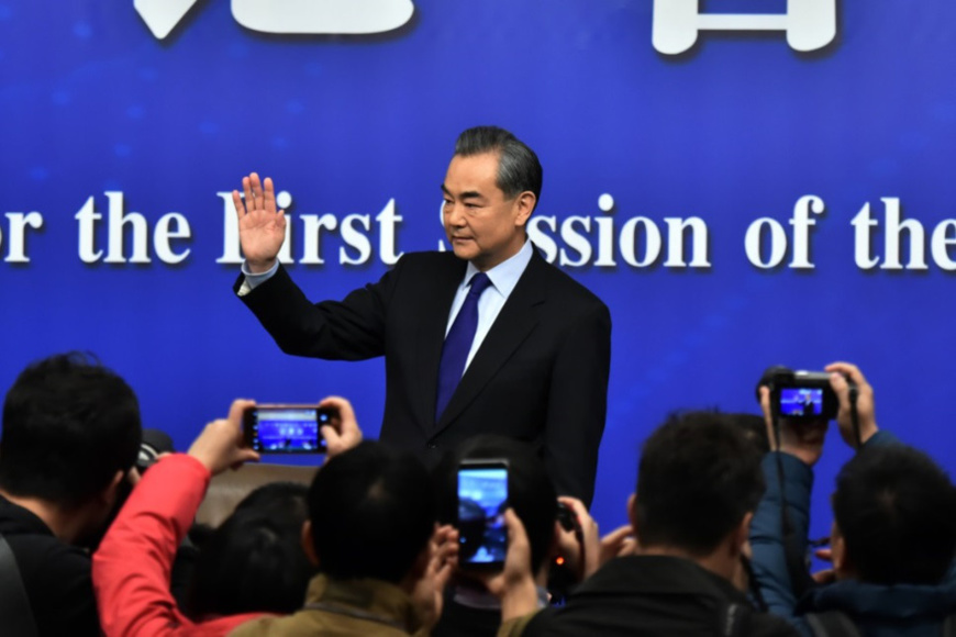 Chinese Foreign Minister Wang Yi meets the press at a press conference of the first session of the 13th National People's Congress, March 8, 2018. (Photo by Weng Qiyu form People's Daily Online)