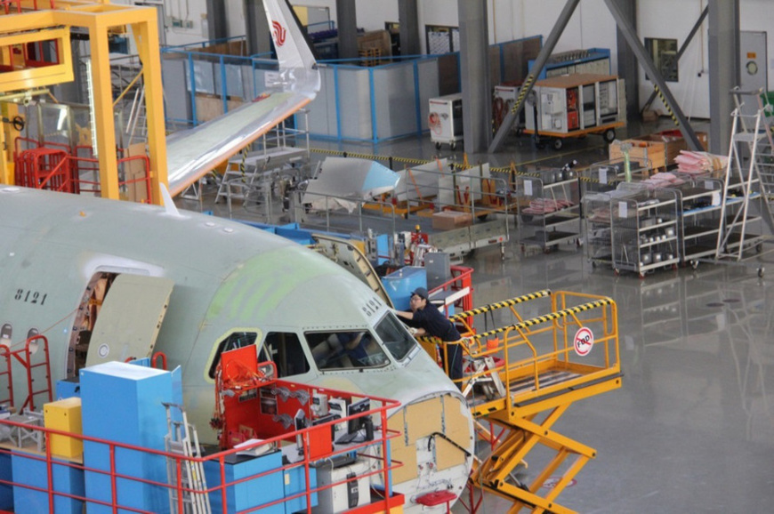 A worker assembles an Airbus A320 family aircraft on a final assembly line in Tianjin. (Photo by Li Yingqi from People's Daily)