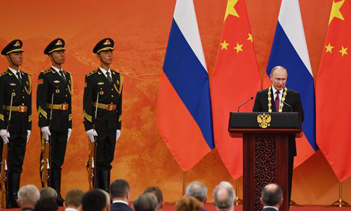 Russian President Vladimir Putin (right) speaks after being presented with the Friendship Medal of the People's Republic of China by Chinese President Xi Jinping at the Great Hall of the People in Beijing on Friday. Photo: IC