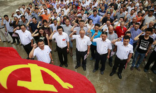 Communist Party of China members review their vows of joining the Party in Hongyan township, Sichuan Province, June 21. Photo: IC