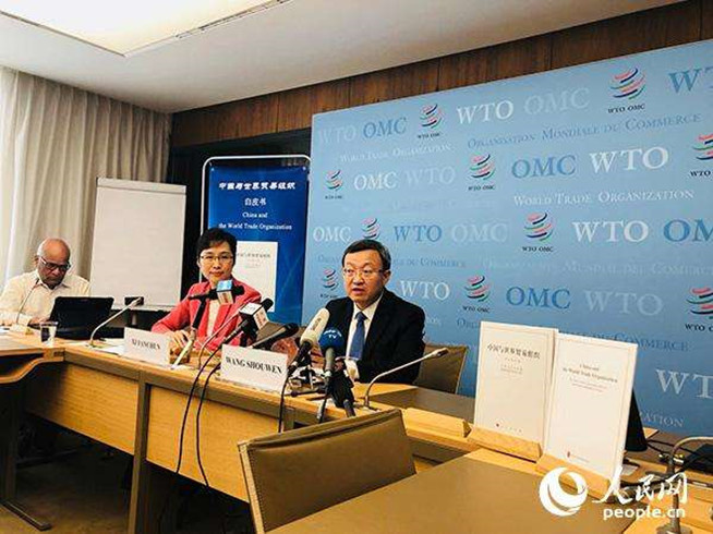 """A press briefing is held to introduce the white paper titled """"China and the World Trade Organization"""" on July 12, 2018 at the WTO headquarters. (Photo from People's Daily Online)"""