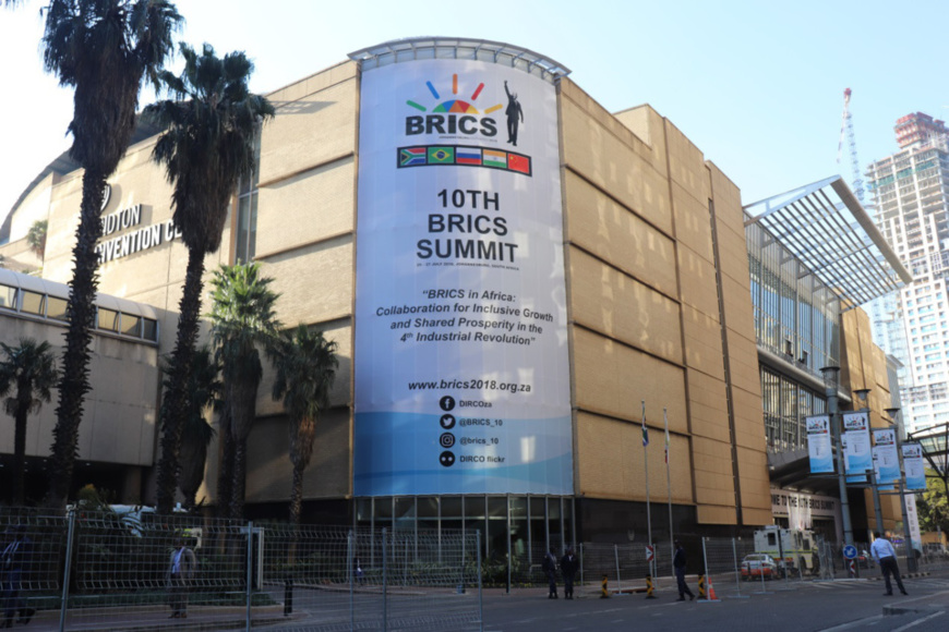 A giant poster of the 10th BRICS Summit hangs on the outer wall of the Sandton Convention Centre. The summit was held in Johannesburg, South Africa from July 25 to 27. (Photo by Liu Lingling from People's Daily)