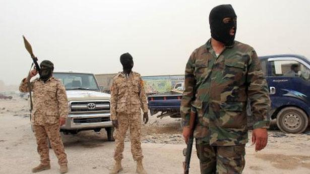 Des hommes en armes en Libye. Crédits photo : DR