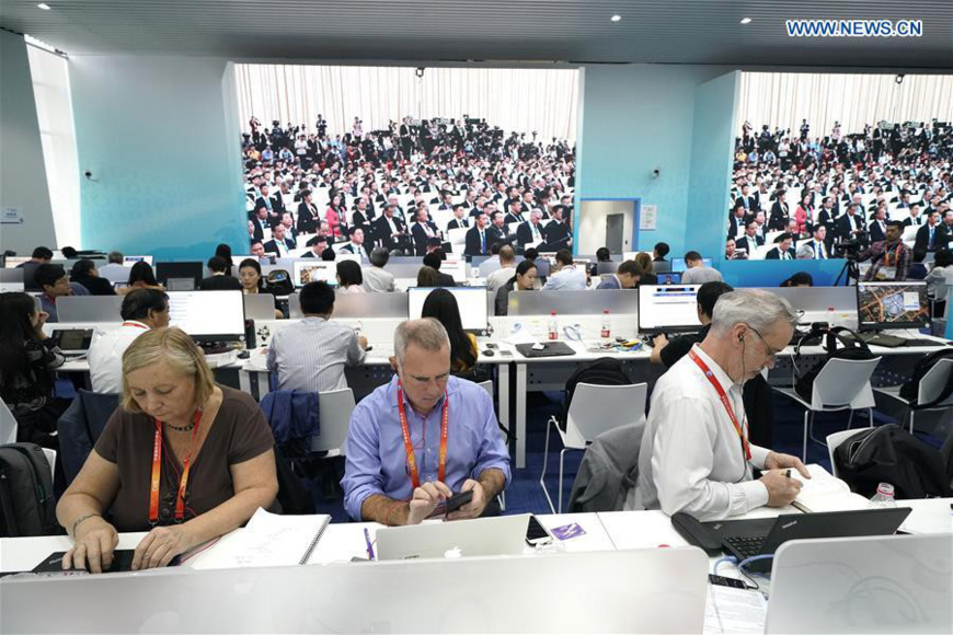 Journalists work at the media center of the first China International Import Expo (CIIE) in Shanghai, east China, Nov. 5, 2018. The first CIIE opened here on Monday and has drawn much attention from domestic and international media. (Xinhua/Shen Bohan)