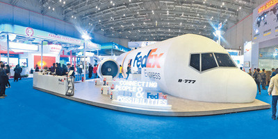 Photo taken is the exhibition booth of US logistic giant FedEx at the ongoing first China International Import Expo (CIIE). The company recently launched a package of logistics solutions in China, including one-stop customs clearance services for cross-border retailers. (Photo by Huang Chao from People's Daily)