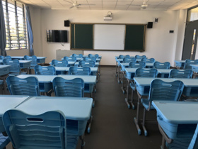 Photo shows classroom utilities including Chinese computers, televisions and projectors. (Photo/People's Daily Online)