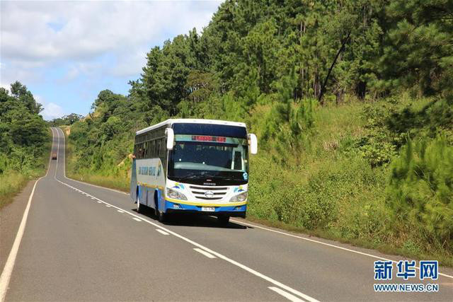 A bus is running on Fiji's Nabouwalu highway undertaken by a Chinese company.