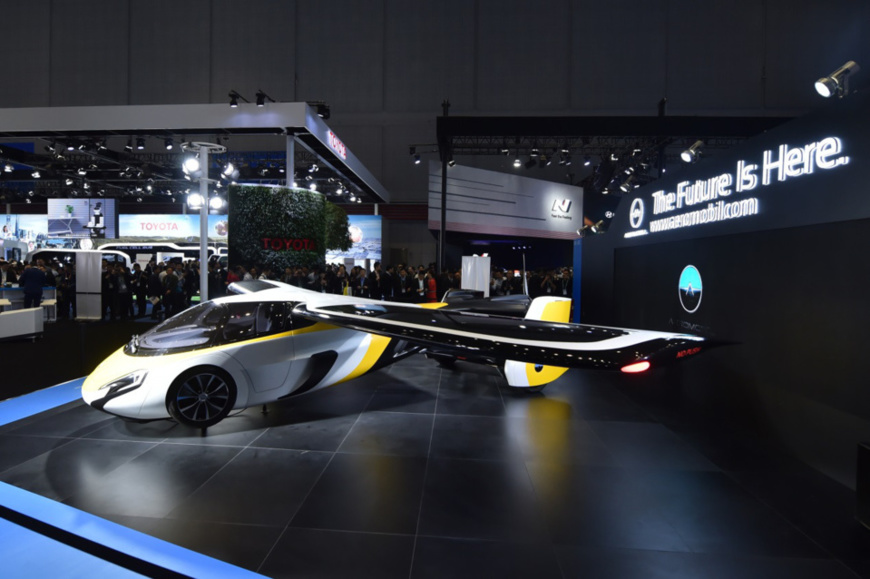 Visitors wow at a flying car produced by AeroMobil from Slovakia at the exhibition area of automobiles during the CIIE. Photo by Weng Qiyu from People's Daily Online