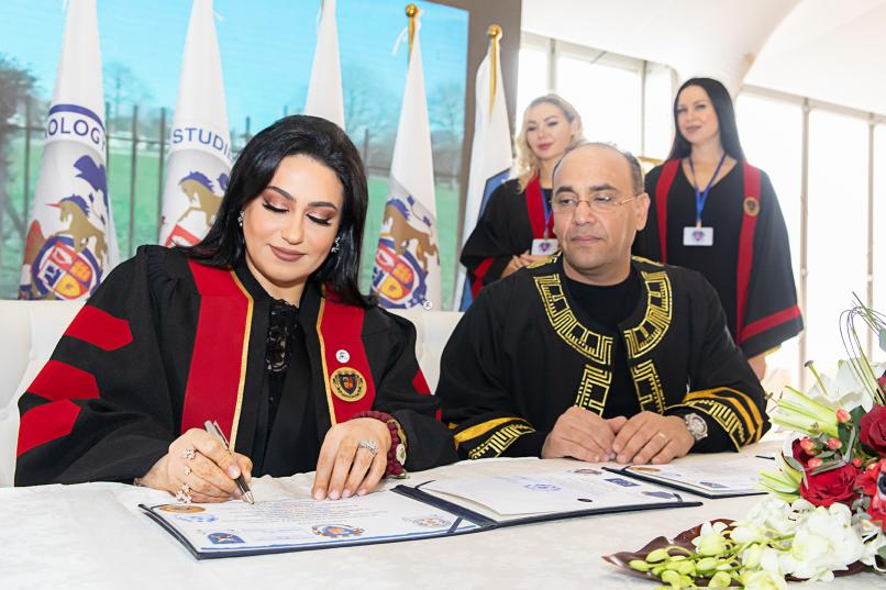 Dr. Nashwa Al Ruwaini Signing at the Award Ceremony of her Honorary PhD from the Oxford College for Research and PHD Studies (Photo: AETOSWire)