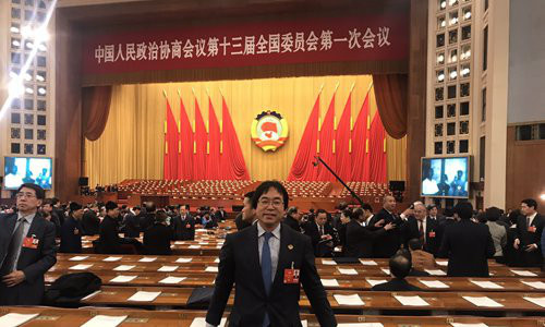 Xu Jingbo, head of the Japan bureau of the Asian News Agency, attended the first session of the 13th CPPCC National Committee in 2018. Photo: Courtesy of Xu Jingbo
