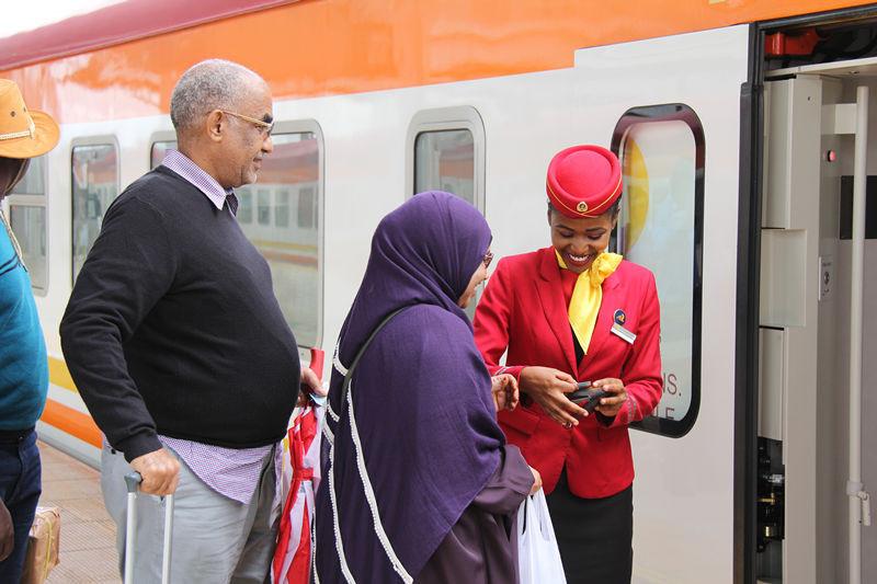 Passengers board a train at the Nairobi South station of the Mombasa-Nairobi Standard-Gauge Railway. Photo by Li Zhiwei, People's Daily
