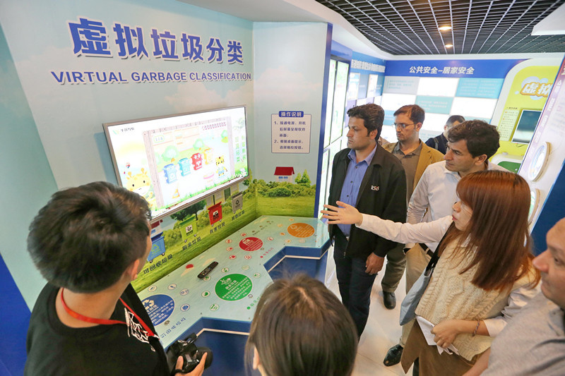 A BRI delegation visits a virtual garbage classification site at a Chinese community science hall, May 9, 2019. (Photo/People's Daily Online)