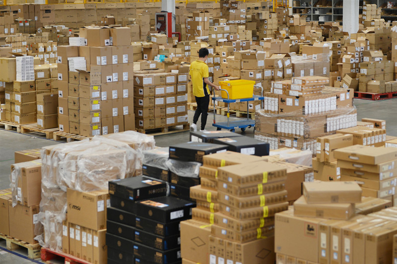 "On June 15th, 2019, with the approach of the ""618"" e-commerce promotion, Jiangsu Nanjing Yuhua Logistics Base has prepared over 20 million stocks, including 3C home appliances, as well as maternal and child, department stores, and fresh food commodity. (Photo by Fang Dongxu from People's Daily Online)"