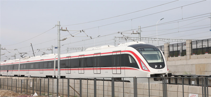 """On June 15, 2019, the first phase of the """"New Beluga"""" train of Beijing New Airport Line was air-tested. The new line of the new airport line runs at a highest speed of 160 kilometers per hour, and has a speed of 117 kilometers per hour. (Photo by Liu Xianguo from People's Daily Online)"""