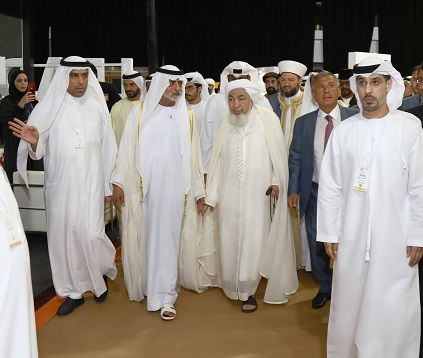 HE Sheikh Nahyan bin Mubarak Al Nahyan touring the WTS collocating exhibition, accompanied by Dawood Al Shezawi, Chairman of the Organizing Committee of the WTS (right) and HE Sheikh Abdulla bin Bayyah, Chairman of the UAE Fatwa Council, and HE Rustem Nurgalevich Menekhanov, President of the Republic of Tatarstan (left). (Photo : AETOSWire).