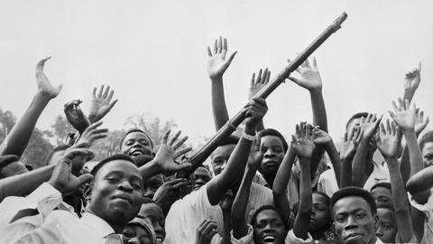 01 Jul 1960, Leopoldville, Congo --- 7/1/1960-Leopoldville, Congo-A group of Congolese wave guns, whoop and shout for joy during the Independence celebrations. --- Image by © Bettmann/CORBIS © Bettmann/CORBIS