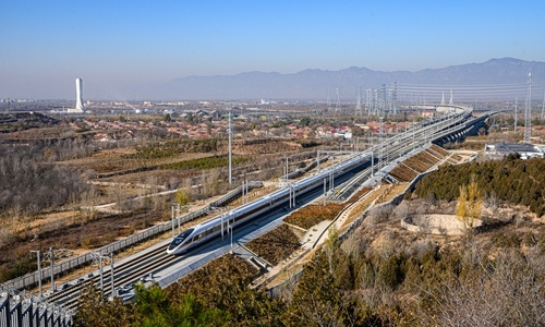 A bullet train tests operations along the high-speed railway line connecting Beijing and Zhangjiakou in North China's Hebei Province in November, 2019. (Photo by CFP)