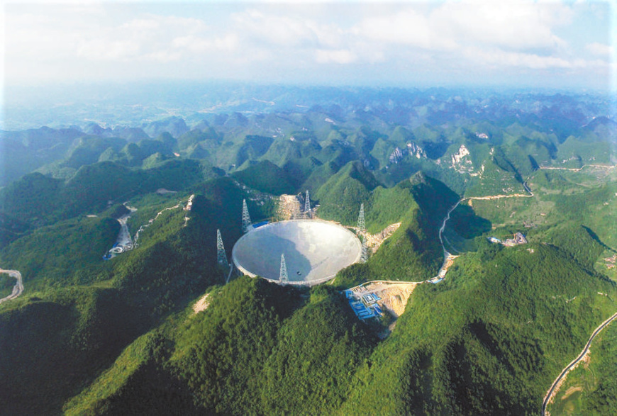 Photo shows FAST located in the magnificent karst mountains of southwest China's Guizhou Province. (Photo by Qin Gang/CPANET.CN)