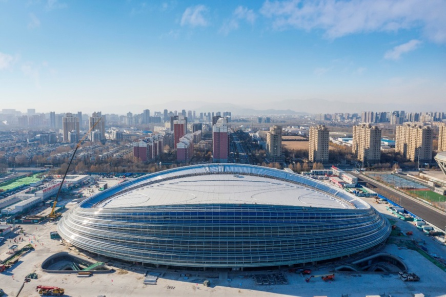"""The landmark venue for the 2022 Winter Olympics - the National Speed Skating Oval, also known as the """"Ice Ribbon"""", is capped, Dec. 31, 2019. Photo by He Yong/People's Daily"""