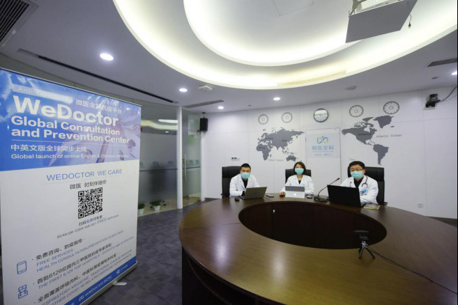 Chinese doctors offer free online consultation for overseas Chinese through WeDoctor in Hangzhou, east China's Zhejiang province, March 17. Photo by Long Wei, People's Daily Online