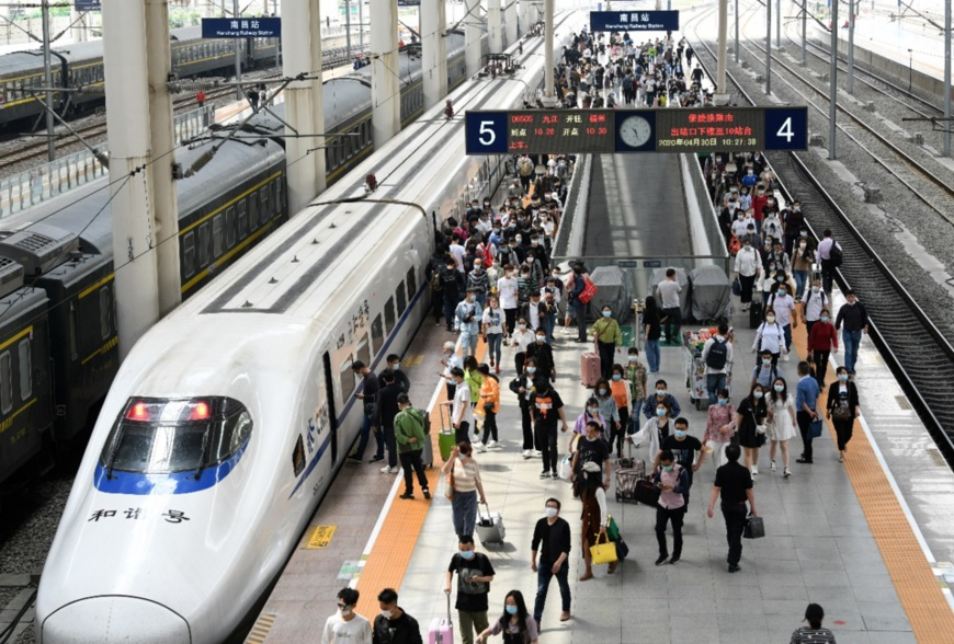 Passengers take bullet trains at Nanchang Railway Station, east China's Jiangxi province, April 30. Photo by Hu Guolin, People's Daily Online