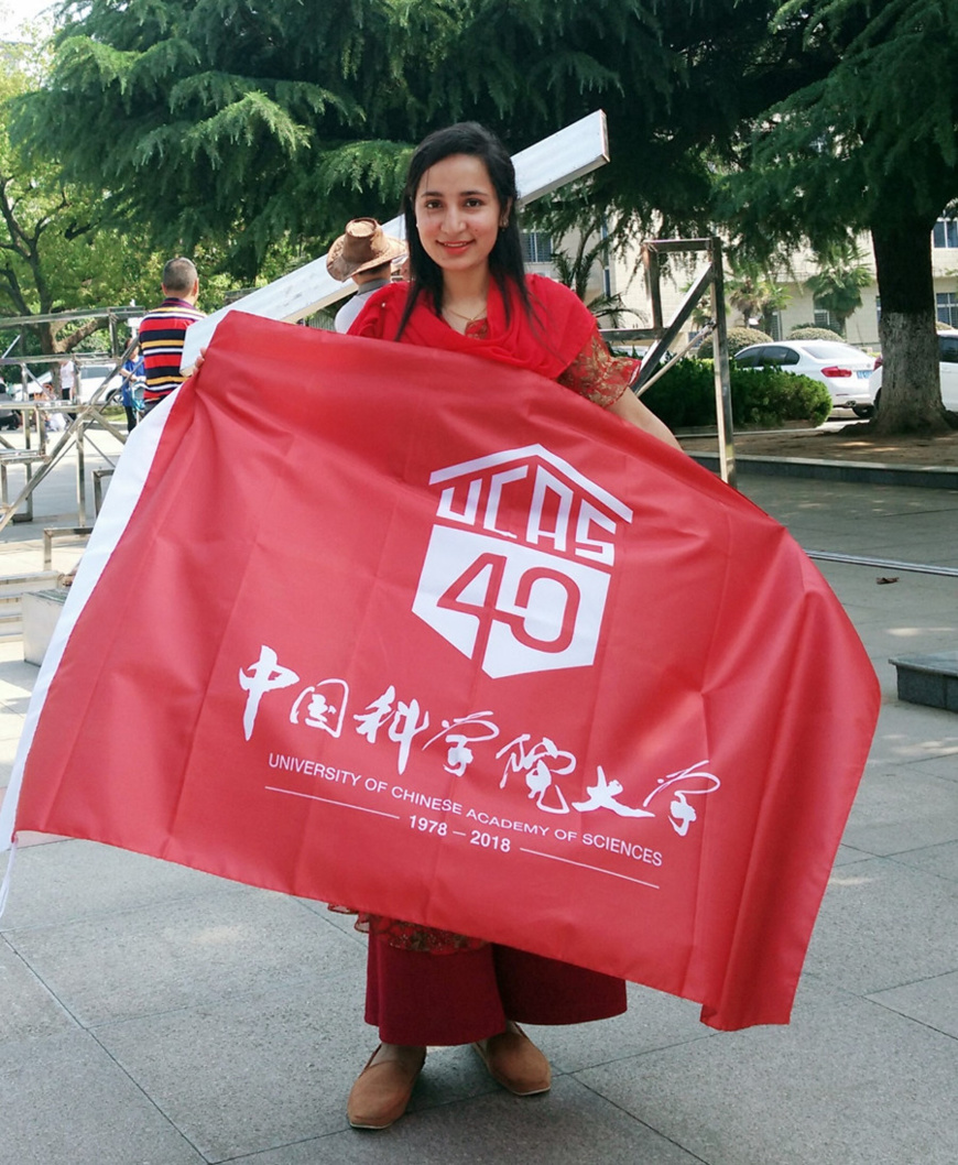 Noor-ul-Huda holds a banner of University of Chinese Academy of Sciences. Photo: Courtesy of Noor-ul-Huda