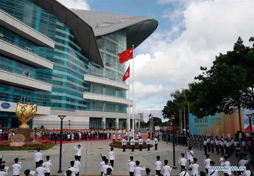 A flag-raising ceremony is held by the government of the Hong Kong Special Administrative Region to celebrate the 23rd anniversary of Hong Kong's return to the motherland at the Golden Bauhinia Square in Hong Kong, south China, July 1, 2020. (Xinhua/Li Gang)