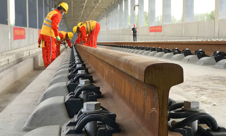 Workers build the Beijing-Xiong'an intercity railway at a construction site in North China's Hebei Province, June 3. Photo by Sun Lijun/ People's Daily Online