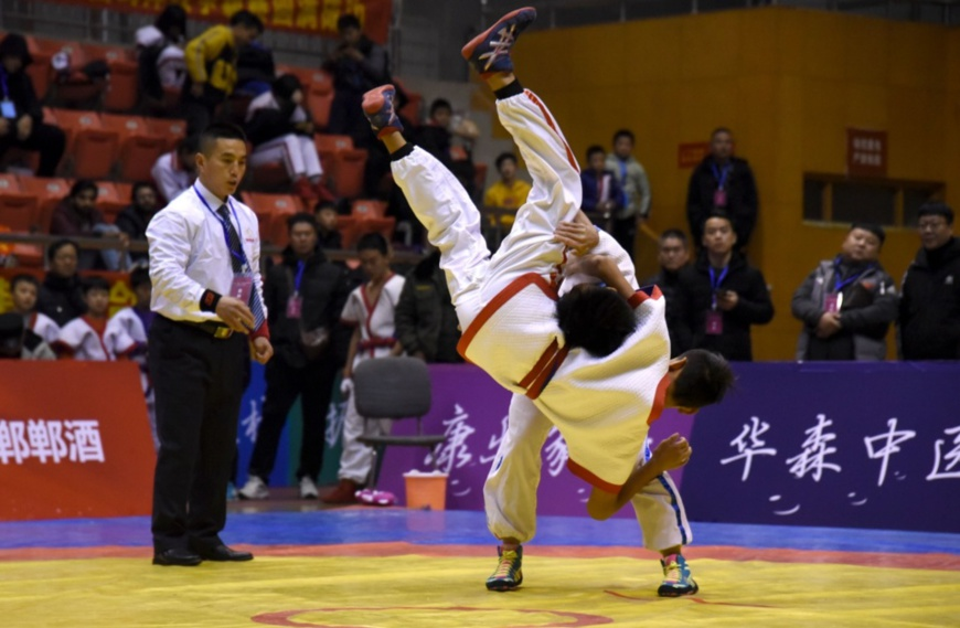 Two athletes compete in a Chinese wrestling game held in Handan, north China's Hebei province. People's Daily Online/Hao Qunying