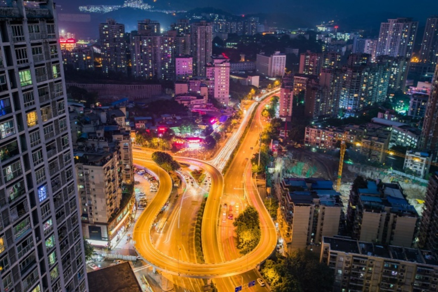 Photo taken in September 2020 shows the night view of a landmark flyover in Shapingba district, southwest China's Chongqing municipality, which mirrors the resilience of the Chinese economy in the post-COVID-19 era. (Photo by Sun Kaifang/People's Daily Online)