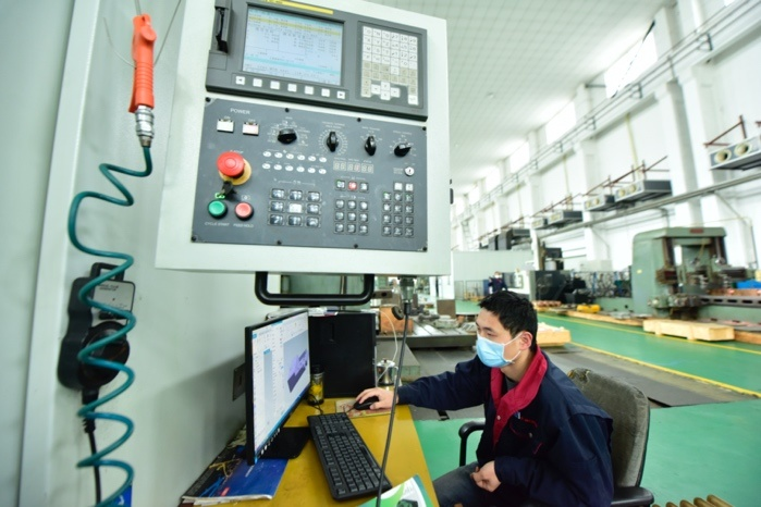 A researcher named Fei Qiang works on the research and development of the ITER correction coil box in a company in Hefei, capital of East China's Anhui Province on Feb. 19. Photo by Ge Yinian/People's Daily Online