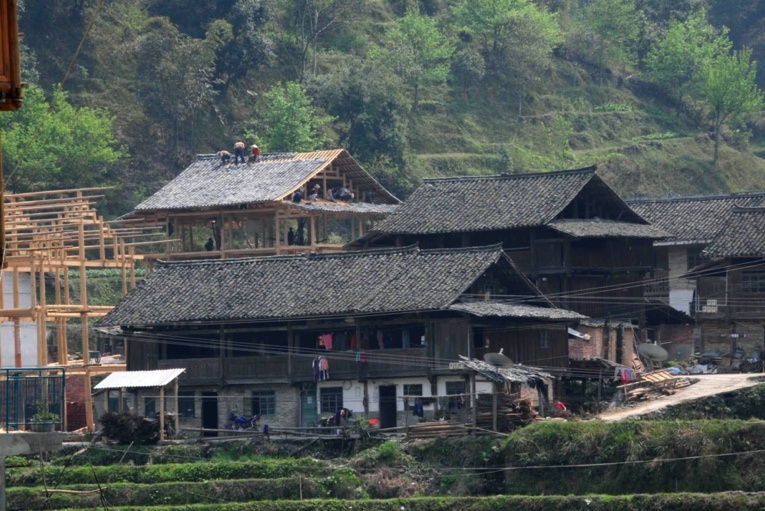 Photo taken in March 2009 shows a dilapidated house in renovation in Liping county, Qiandongnan Miao and Dong autonomous prefecture, southwest China's Guizhou province. (Photo by Zhang Jing/People's Daily Online)