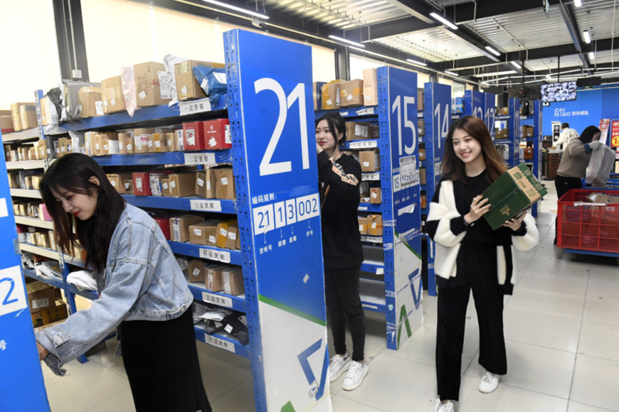 "A parcel pickup station in a university in southwest China's Sichuan province is well prepared for the peak time of the ""Double 11"" online shopping festival by simplifying pickup procedures for students. (Photo by Li Xiangyu/People's Daily Online)"