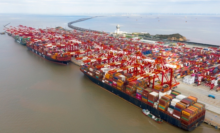 Vessels are busy handling cargos at the Yangshan Deep Water Port, Shanghai, Oct. 25. Photo by Ji Haixin/People's Daily Online