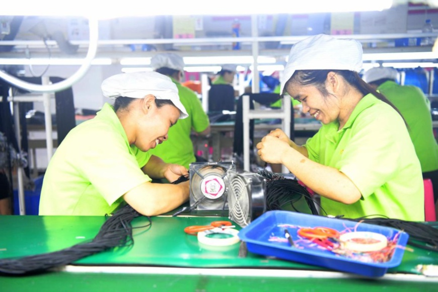 Female workers work in a poverty alleviation workshop of an electronic plant in Luocheng Mulao autonomous county, south China's Guangxi Zhuang autonomous region, June 12, 2020. (Photo by Meng Zengshi/People's Daily Online)