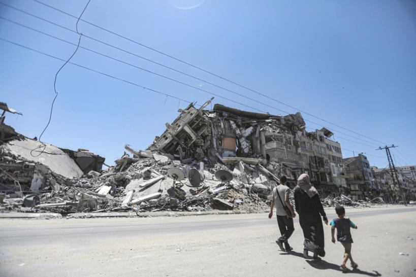 Un bâtiment endommagé par une frappe aérienne israélienne dans la ville de Gaza. Crédits : UNRWA/Mohamed Hinnawi