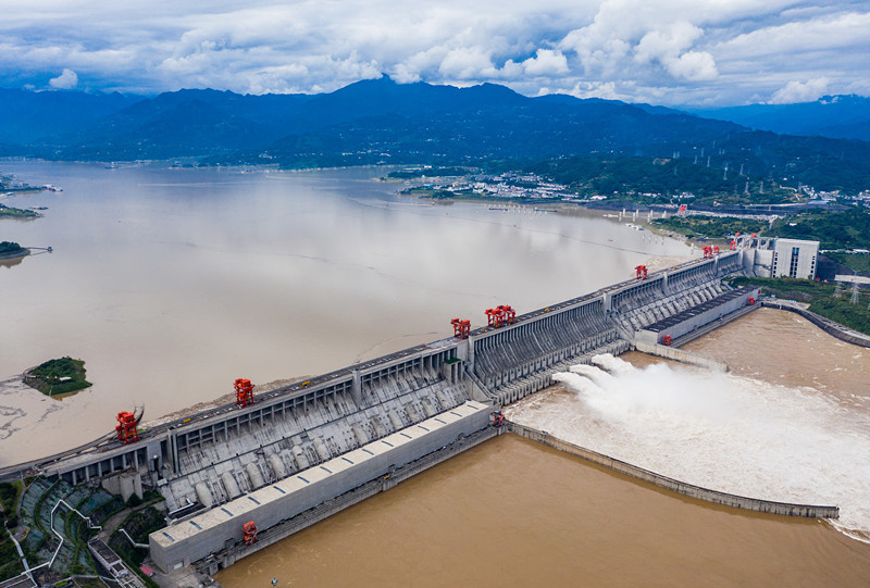 The Three Gorges Dam in central China's Hubei province opens three spillways to discharge floodwater, allowing the passage of the first flood of China's Yangtze River this year, Sept. 7, 2021. (Photo by Zheng Jiayu/People's Daily Online)
