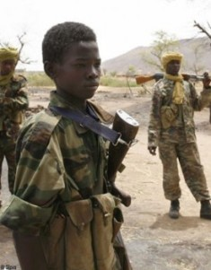 Un enfant soldat. Crédit photo : Sources