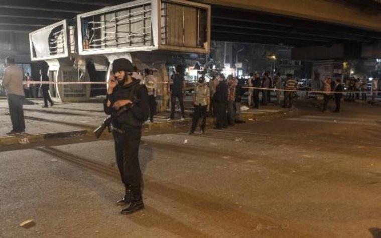 Surveillance policière après une explosion visant la police au Caire le 19 avril 2014, qui a causé la mort d'un officier de police. AFP/Archives