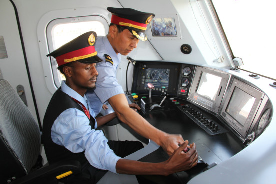 Connecting Addis Abeba with Djibouti-ville, Yaji Railway is the first cross-border electrified railway which uses Chinese construction standard. The Chinese company will be in charge of the first six years' operation. The picture shows a Chinese train driver is training an Ethiopian staff. Photo by Li Zhiwei from People's Daily